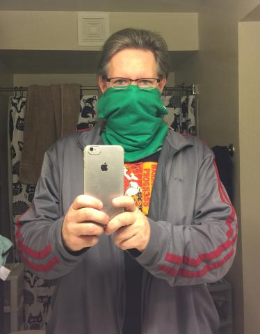 Mirror selfie of the author wearing a hand-sewn mask