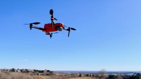 HUGIN III, an Evo II, is one drone shown flying against a clear blue sky.