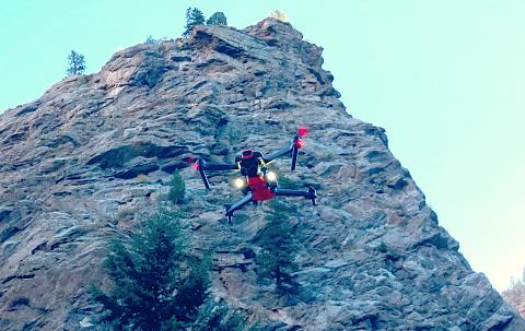 Quadcopter drone Hugin II before rock escarpment
