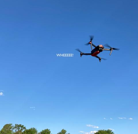 text WHEEE following Autel Evo drone in flight