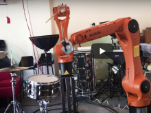 Image used by fair use, showing robotic arm and drums